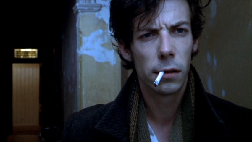 Noah Taylor smoking a cigarette (or weed)